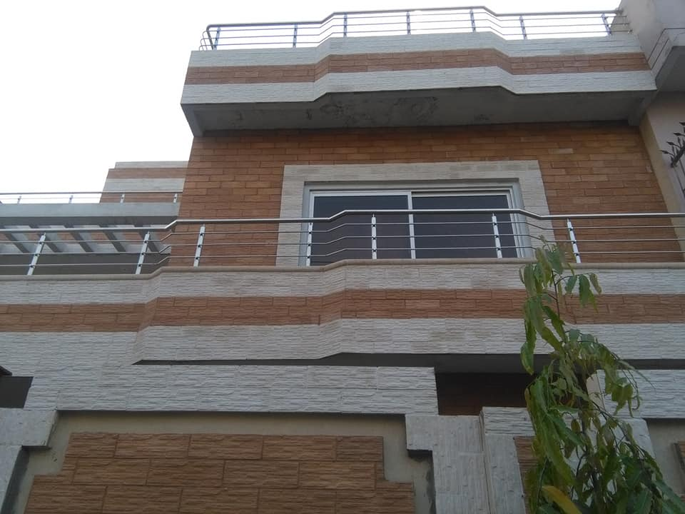 front wall house face stone tiles design in pakistan