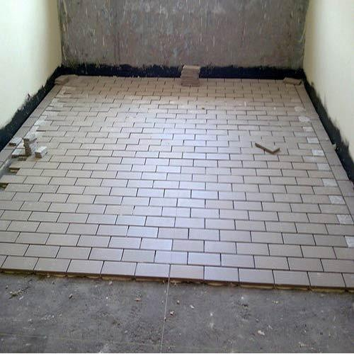Acid resistant tiles laying procedure